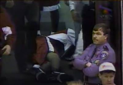 Marcus Camby lies motionless after collapsing.